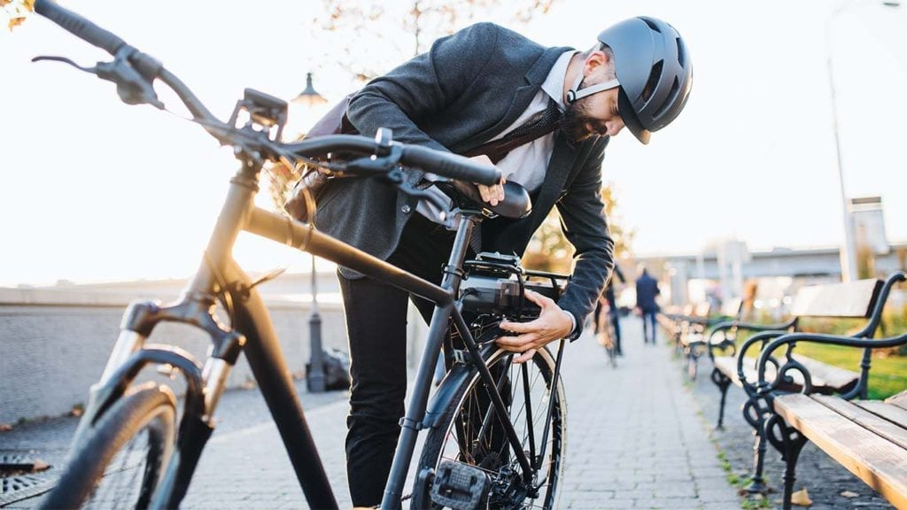 hipster-businessman-commuter-setting-up-electric-W82635J-copy